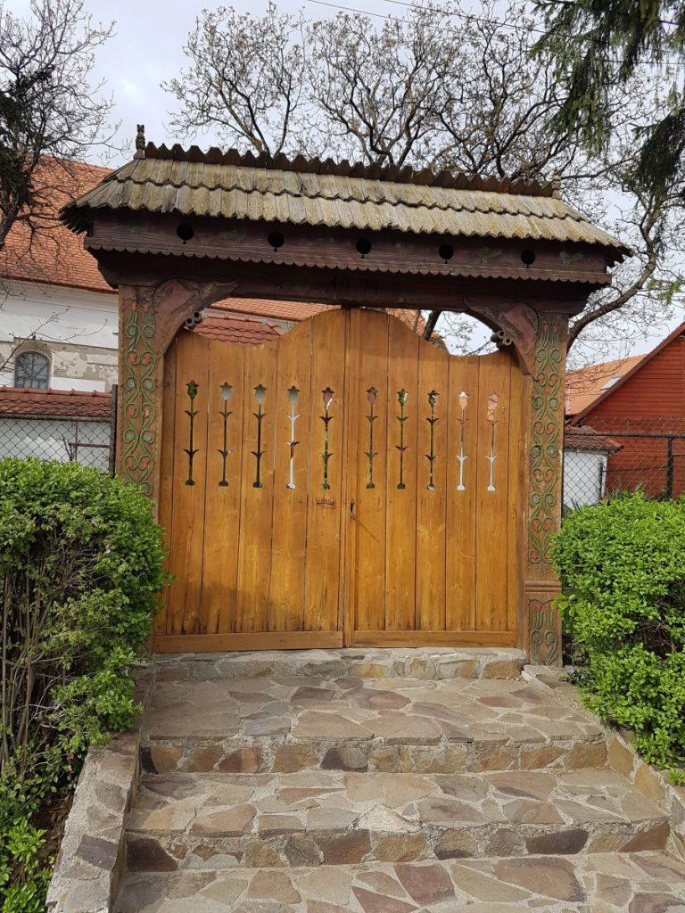 Wood carved gate in Corund Village