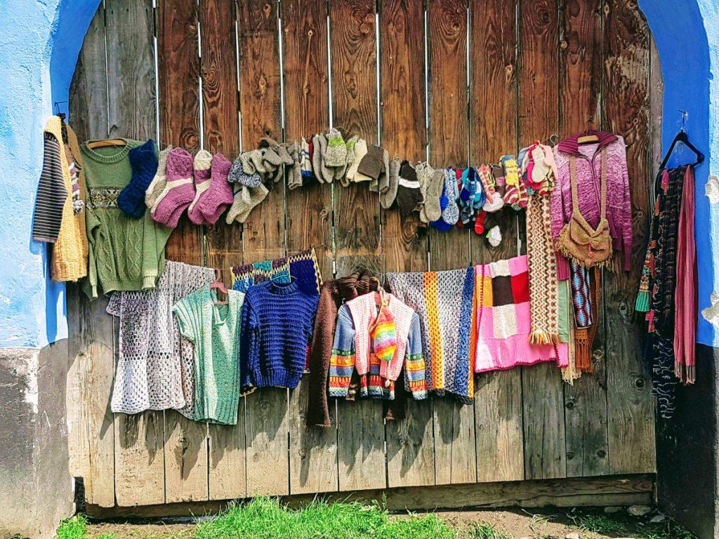 Handmade clothes displayed on the street - Viscri Village Romania