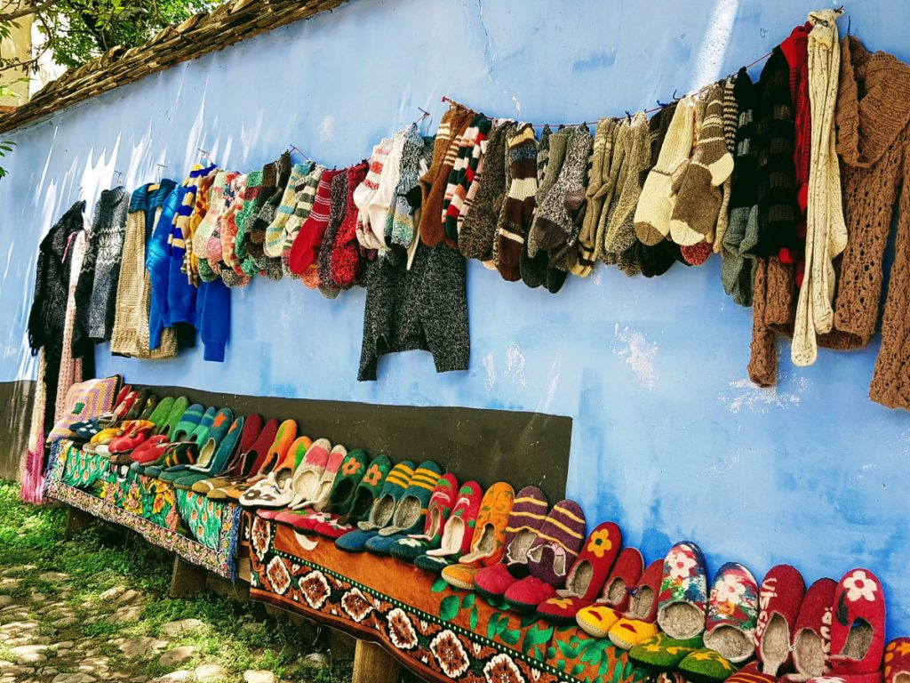 Handmade clothes displayed on the street - Viscri Village Romania